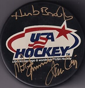 BECKETT HERB BROOKS-JIM CRAIG-MIKE ERUZIONE MIRACLE ON ICE USA OLYMPIC PUCK 7978