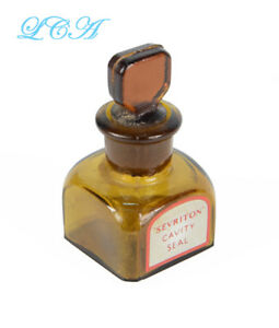 Tiny antique Sevriton CAVITY SEAL antique AMBER bottle w/ground GLASS STOPPER