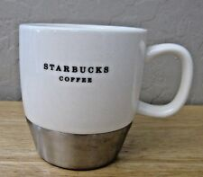2006 STARBUCKS WHITE CERAMIC MUG WITH A STAINLESS BAND NEAR THE BASE