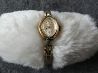 Vintage Helbros Wind Up Ladies Watch with a Stretch Band