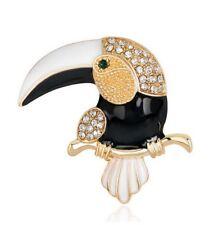 Broche mignon perroquet doré et noir strass blanc.