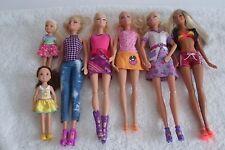 Lote De Muñecas Barbie bastante vestida (4)