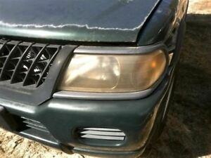Driver Left Headlight Color-keyed Bezel Fits 00-04 MONTERO SPORT 337891