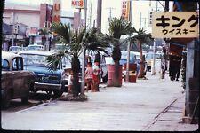 Org Photo Slide 1960's Vietnam war military Town city street scene car sign park