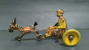 Vintage German Tin Wind up  Zebra Pulling Comical Man  George Levy (Gely) 1930s