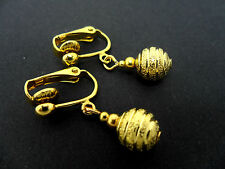 A PAIR OF CUTE LITTLE GOLD COLOUR 8MM BEAD DANGLY CLIP ON EARRINGS. NEW.