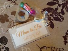 A new mum to be survival kit in organza bags for baby shower