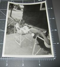 VINTAGE PHOTO FUNNY ODD WOMAN IN CHAIR HIDES FACE BEHIND TOY DOLL Snapshot #1