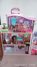 Doll House + 6pcs of  Dolls,Pink  Car,Clothing for Dolls, Palm Tree.