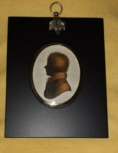 Portrait Miniature of a gentleman in silhouette in an acorn hanger black frame