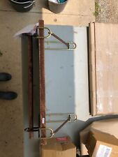 Wall shelf wood, leather, metal never used comes with hardware and instructions