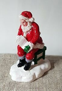 Lemax, Dept 56, other. Figurine. Santa reading a book.