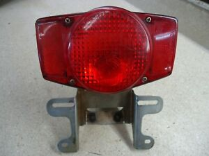 1975-1976 HONDA CB550 REAR TAIL LIGHT OEM LICENSE PLATE BRACKET