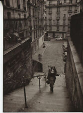 Post Card Of A Black And White Picture Of A Girl Walking Up Steps In Europe