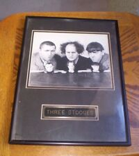 A 16 by 12 GLASS FRAMED PICTURE OF THREE STOOGES
