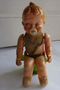 Vintage Plastic Baby Doll on Toilet With Lever & Squeaker
