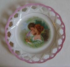 An Edwardian Porcelain Ribbon Plate decorated with two beautiful girls...