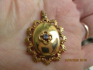 Magnifique ancien pendentif porte-photo en plaqué or