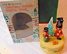 2 Toy Soldiers & a Christmas Tree on a Wooden Musical Stage