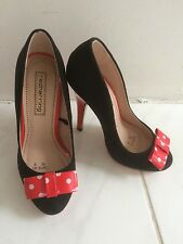 NWT Red herring red & black suede heels with white polka dots and red bow.