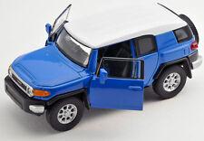 BLITZ VERSAND Toyota FJ Cruiser blau / blue Welly Modell Auto 1:34 NEU & OVP
