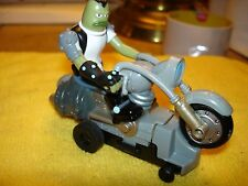 Green figure from spongebob on motorcycle 1/43 slot car offered by MTH.