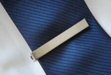 Pinces et fixe-cravates pour homme