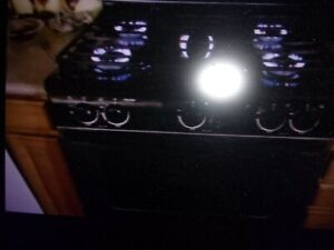 Whirlpool Gas Stove used stainless steel and black