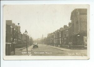 Real photo postcard of Park road with car in Colliers Wood Merton London in gc