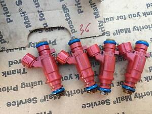 Bosch Set Of 4 Fuel Injectors for Nissan 1.8L