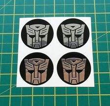 LEGA RUOTA ADESIVI 4 x 50mm TRANSFORMERS Autobot Chrome centro CAP badge TRIM