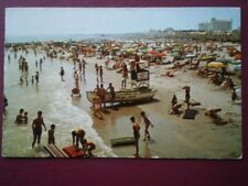 POSTCARD USA OCEAN CITY - NEW JERSEY ENJOYING SURF AND SAND -