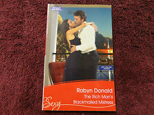 THE RICH MAN'S BLACKMAILED MISTRESS  BY  ROBYN DONALD =MILLS & BOON=SEXY=