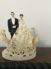 Antique/vintage wedding cake topper with bride and groom, heavy type base