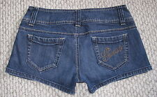 GUESS JEANS GOLD STUDDED LOGO POCKET 26 STRETCH JEAN SHORTS