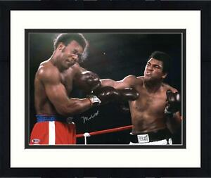 """Framed Muhammad Ali Autographed 16"""" x 20"""" Punching Foreman Photograph"""