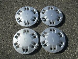 Genuine 1988 to 1990 Pontiac Lemans 13 inch hubcaps wheel covers beaters