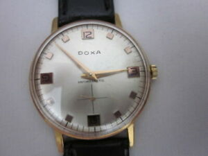 Doxa men's vintage, manual winding, very clean no scratches in good working cond