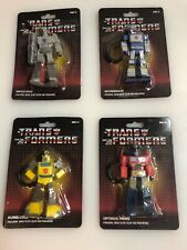 Lot Of 4 Transformers G1 Keychain Bag Clip Optimus Megatron Bumblebee Soundwave