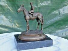 cheval et son jockey en bronze sur socle signé .