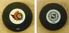 LOT OF 2 HOCKEY PUCKS -NHL OFFICIAL IN GLAS CO - OTTAWA SENATORS  - FREE SHIP