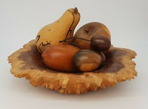 WOODEN FRUIT IN WOODEN BOWL.