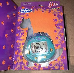 Original RakuRaku DinoKun Dinkie Dino Electronic Virtual Pet TK-910