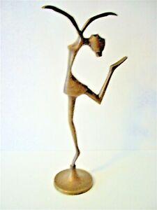 A VINTAGE BRONZE SCULPTURE OF A DANCING BALLERINA .