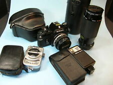 NIKON EM 35mm SLR CAMERA w/ 50mm & 80-200mm LENSES, SB-E Flash, Meter, Case