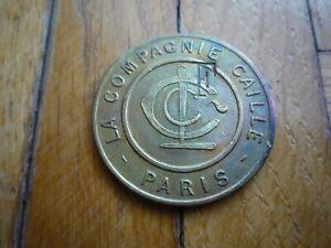FRANCE Jeton en laiton de la Compagnie Caille CASINO  Paris avec tampons F- RARE