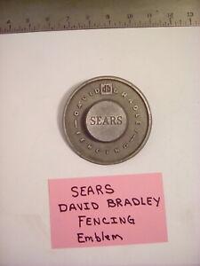 "VINTAGE SEARS / DAVID BRADLEY FENCING NAME PLATE EMBLEM.  ALUMINUM, 4"" DIA. USED"