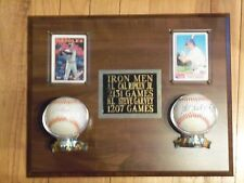 Cal Ripken and Steve Garvey.  ML and NL iron men plaque with autographed balls