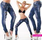 jeans skinny strappi meccanici con rete nera dettagli lurex taglie XS,S,M,L,XL