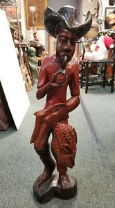 Mid 20th Cent. Haitian Man Smoking Pipe/Holding Fish Hand Carved Wooden Sculpt.